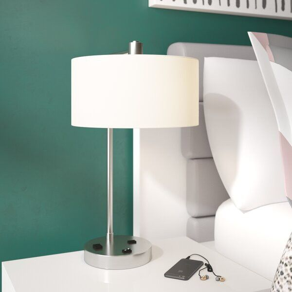 This lamp has a USB port and an outlet, so you can charge all your devices while you sleep.