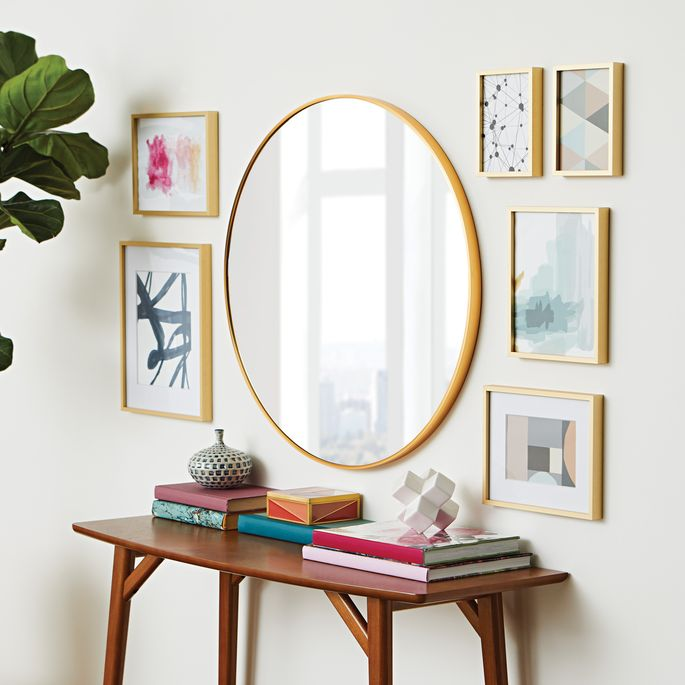 Anchor an arrangement with this classic round mirror.