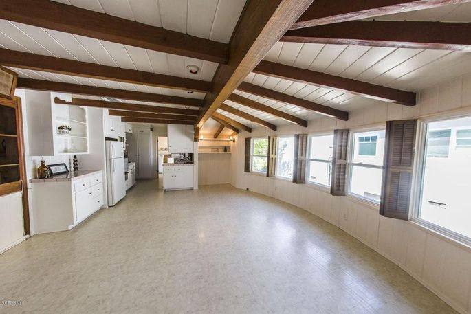 This awkward kitchen layout and vinyl flooring would send some buyers running.