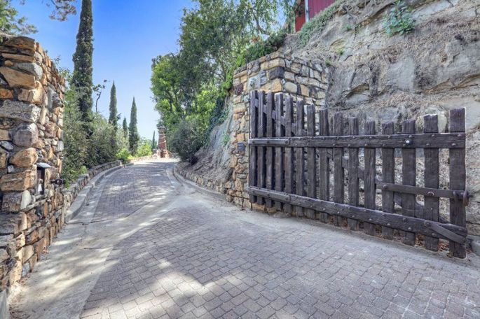 Los Feliz, CA, compound hidden behind gates and a long driveway