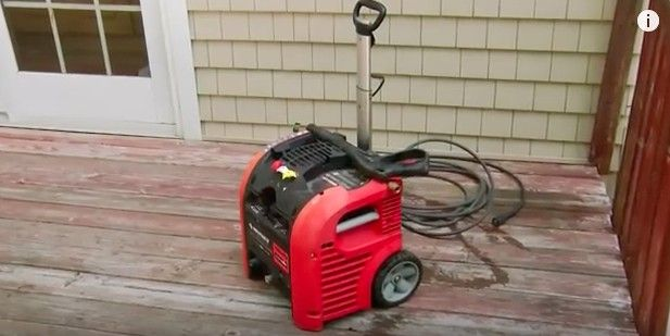 A quick way to clean a deck is to use a pressure washer with a high-powered water stream.