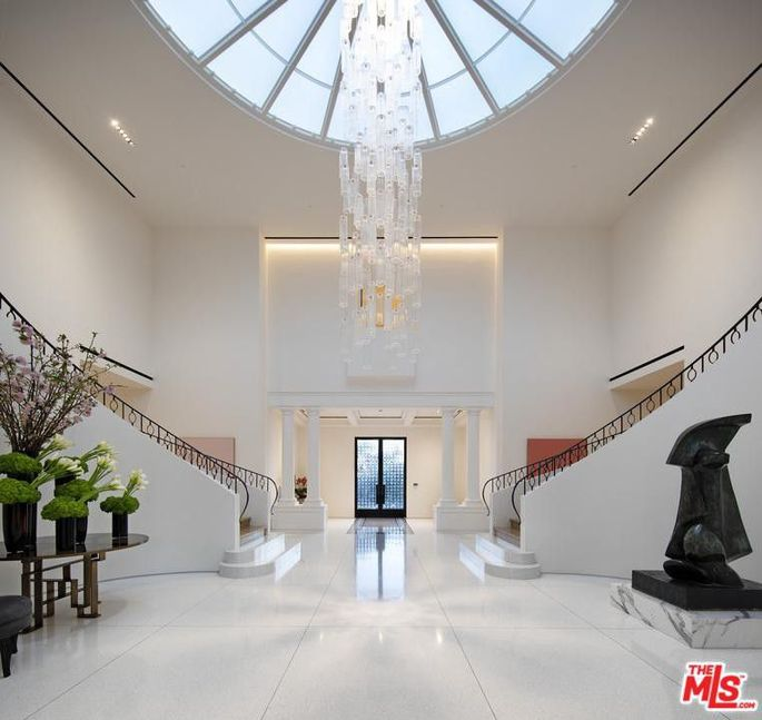 Foyer with two-story chandelier
