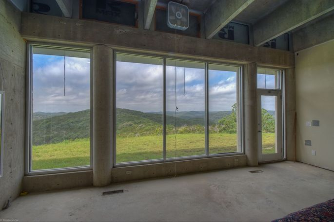 This brutalist house for sale in texas isn 39 t an eyesore Floor to ceiling windows for sale