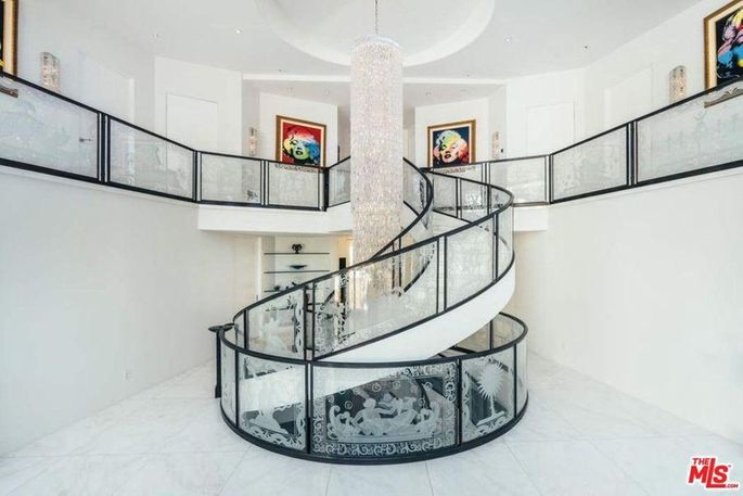 Staircase with floor-to-ceiling chandelier