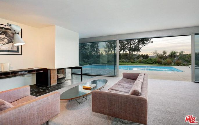 """Living room withfireplace, """"a Neutra signature piece of sculpture"""""""