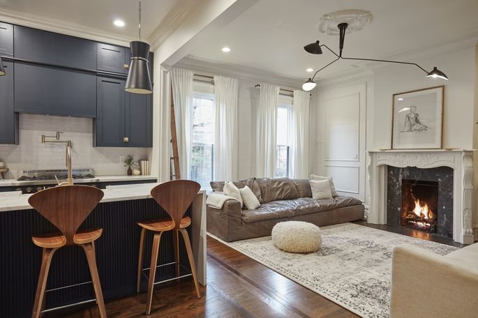 The living and kitchen area of the Williamson home includes vintage-style moldings. The couple spent $200,000 and nearly three years renovating the home.