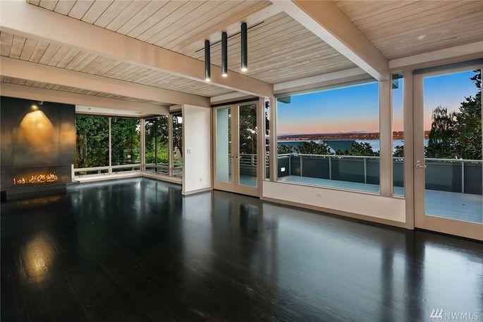 Open floor plan with floor-to-ceiling windows
