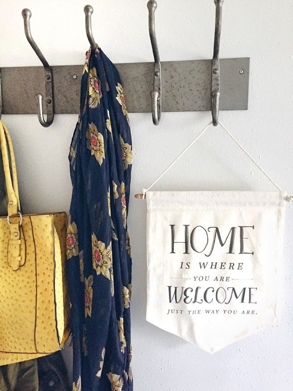 Michaels suggests starting to organize the second you walk in the door, by having coat hooks and cubby holes by the entryway the family uses the most.