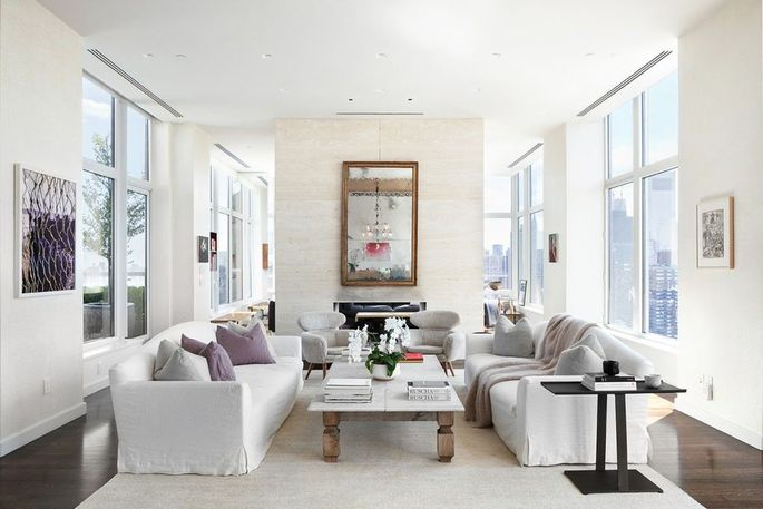 With a 12-foot ceiling and large windows, this living room feels airy and inviting.