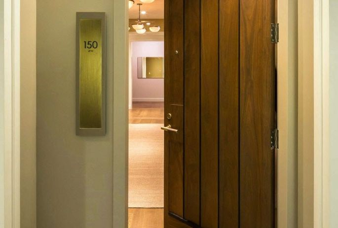 150 Charles has 8-foot walnut doors