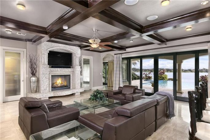 Living room with gas fireplace and coffered ceiling