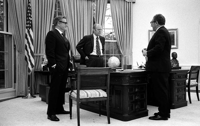 President Gerald R. Ford meeting in the Oval Office with Vice President Nelson Rockefeller and Secretary of State Henry Kissinger