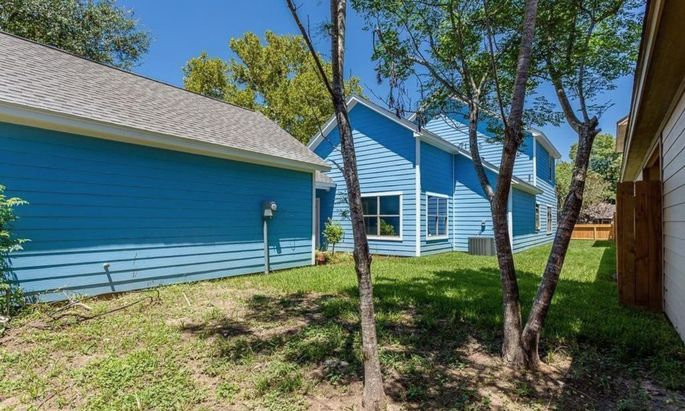 The bright blue house comes with outbuildings too.