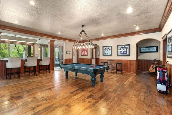 Game room and bar with sports memorabilia