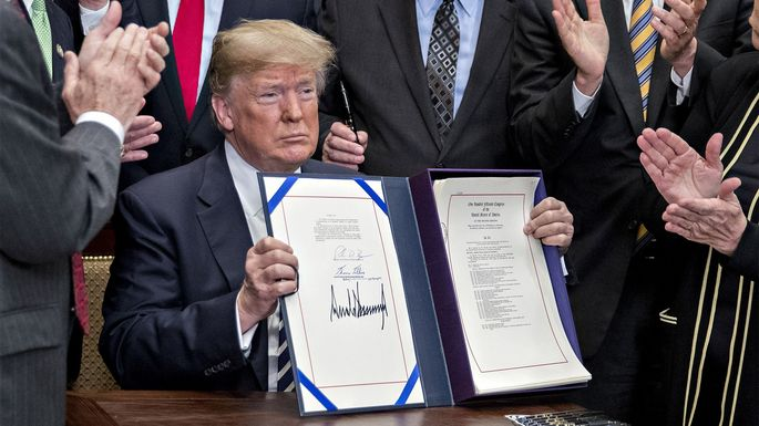 President Donald Trump signed legislation rolling back