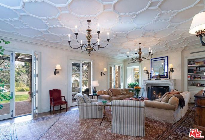 Family room with ornate ceiling design