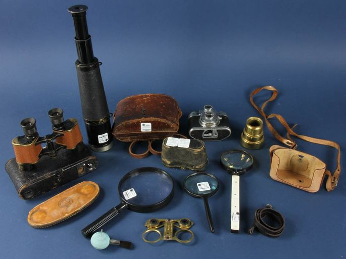 Vintage binoculars, cameras, and magnifying glasses up for auction