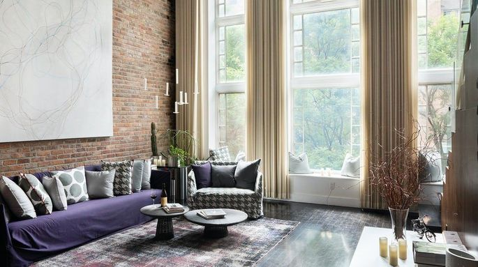 Living room with soaring windows and 22-feet ceilings