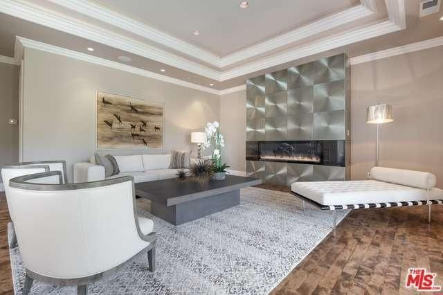 Contemporary fireplace in Studio Cityhome