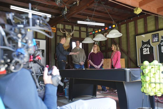 Tiffany and Rob Riggle consult with clients on a garage-to-family room conversion.