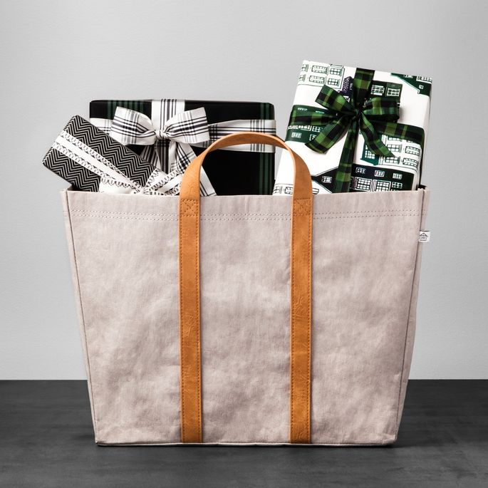 This utilitarian storage bin does double duty as a tote.