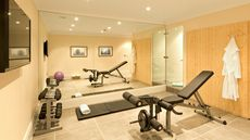 Help, There's a Peloton in My Living Room! Home Gym Designs You Won't Hate