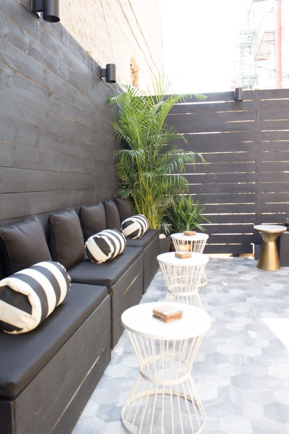 Chic tile works inside as well as out in this patio design.