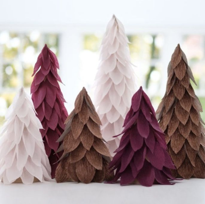 Creating trees out of crepe paper is an easy, rental-friendly way to decorate during the holidays.