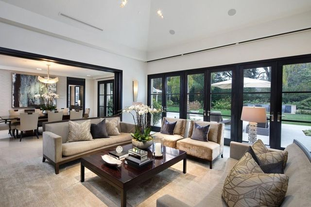Living room with floor to ceiling windows and doors