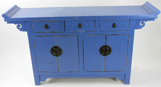 A Chinese-style sideboard painted a bold blue, which is being auctioned off as part of the Martha Stewart collection