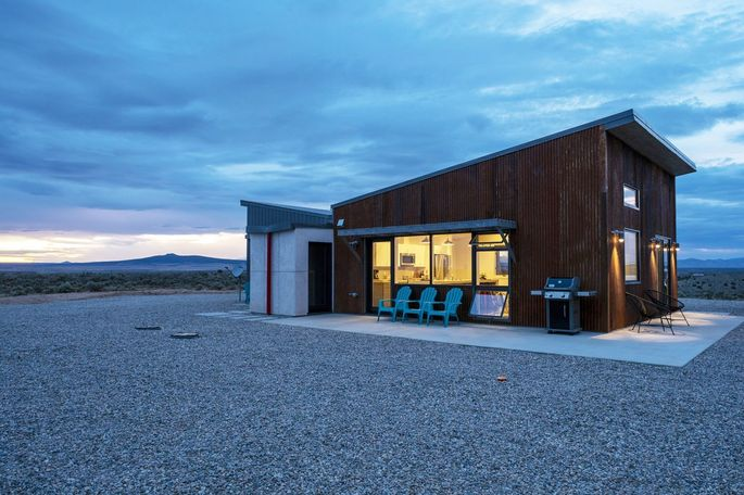 Austin and Randall Slimp's two-bedroom weekend home in Taos, N.M. A butterfly-shaped roof funnels rainwater to two large cisterns.