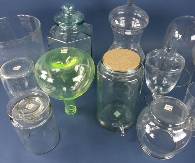 A group of 15 vintage colored glass bottles is available for bidding.