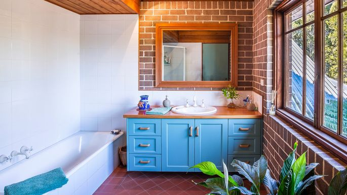 What Is a Bathroom Vanity? | realtor.com® What Is A Bathroom Vanity on a bathroom with shower, a bathroom sink, a bathroom mirror,