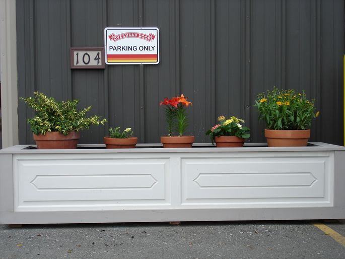 Raise up! This old garage door makes a beautiful planter.