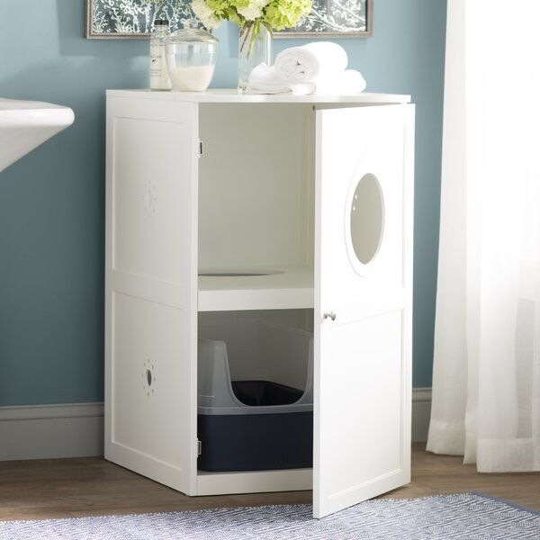 Keep your litter box stashed in this cabinet, which has a little window for your kitty.