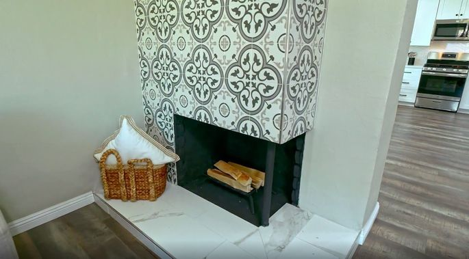 With stylish tile, this fireplace looks stunning.