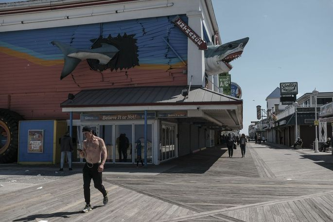 Visitors walk along the boardwalk in Ocean City, Md., on May 13.