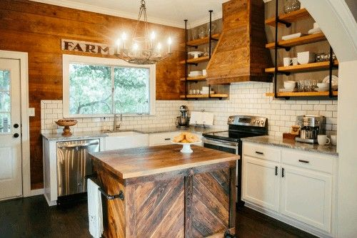 A kitchen clad in reclaimed wood planks