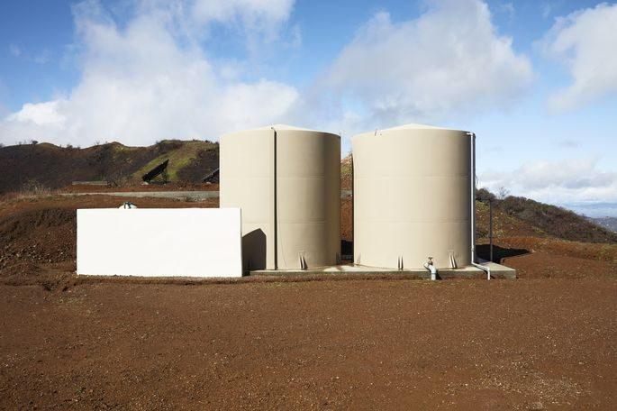 The fire safe features included concrete-and-steel walls, rooftop ember guards, heat resistant windows and a 1,000-foot-long hose supplied by these tanks, which along with others on the property hold 50,000 gallons of water.