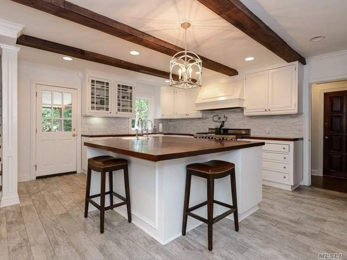 Gourmet kitchen with beamed ceilings