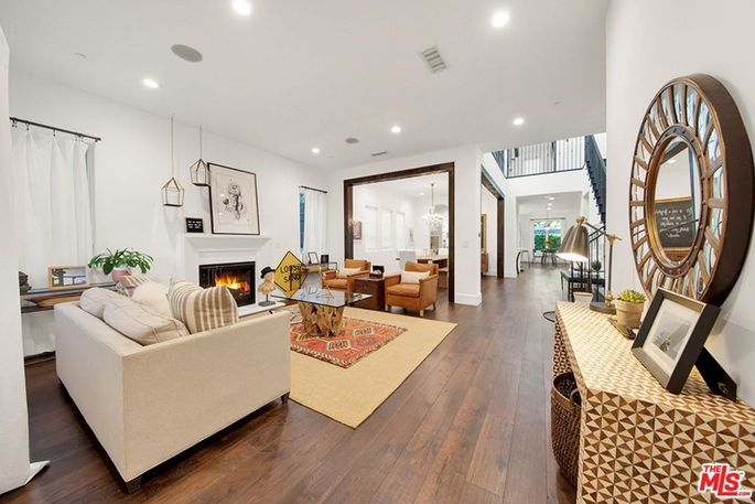 Living room with fireplace in Studio City, CA, home