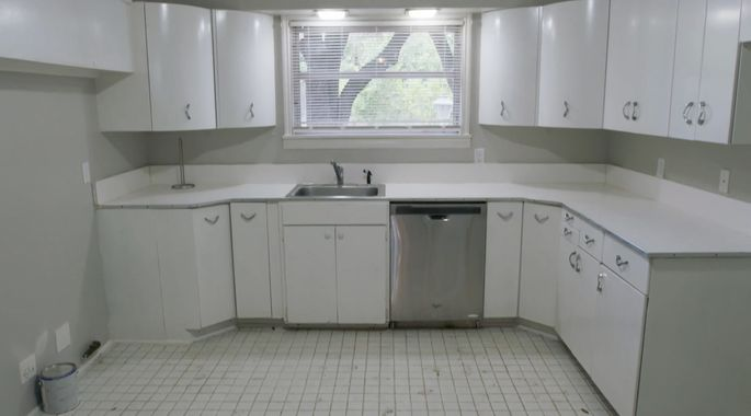 Before: These curved upper cabinets provide some inspiration for Joanna.