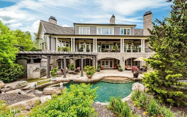 Backyard with saltwater pool and spa