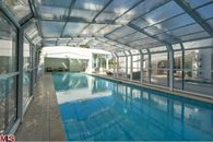 Hancock Park Manse Has Pool with Retractable Glass Enclosure for Year-Round Swimming