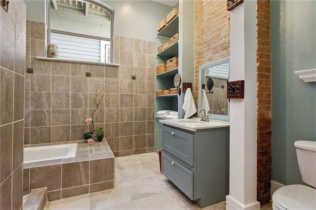 Luxe bathroom with original brick wall
