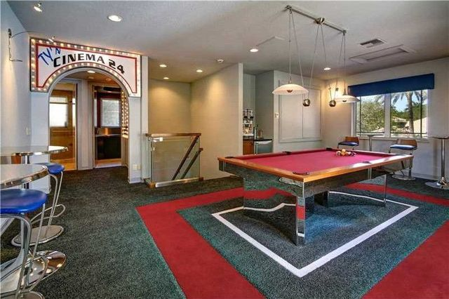The game room, with the entrance to the home theater.