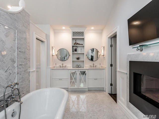 Master bath with fireplace and TV