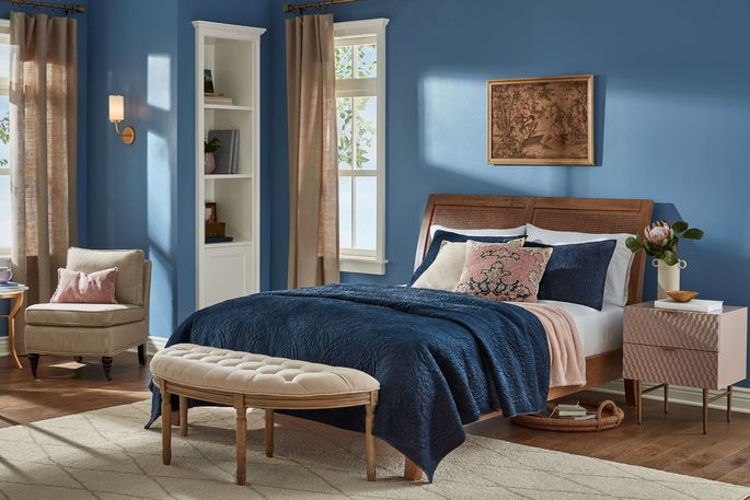 Calming shades of blue and beige lend tranquility to a bedroom.