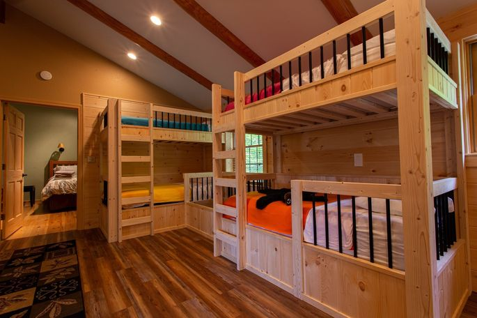 A large children's playroom at Black Bear Lodge sleeps five and has an indoor slide.