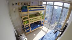 This Man Lives With His Five Young Kids in a 1,050-Square-Foot Apartment